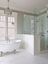 bathroom ideas with clawfoot tub large glass windows with light grey wall color and modern