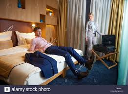 young couple room young couple in modern hotel room stock photo royalty free image