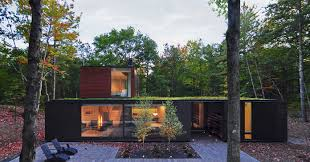 modern home in a forest at lake michigan