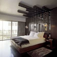 love the use of the wood and hanging fixtures bedroom designs