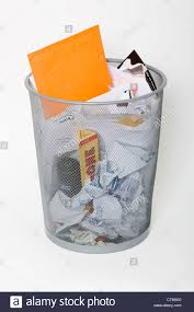 waste paper baskets waste paper basket filled with rubbish stock photo royalty free