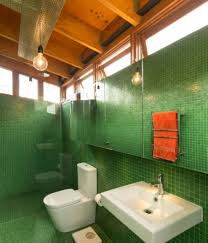 forest green bathroom tiles colors with white toilet and sink and