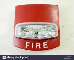 wall mount strobe light red fire alarm strobe light smoke detector mounted on a wall as part
