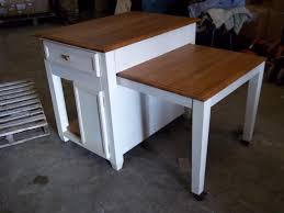 Kitchen Pull Out Cabinet by Www M37auction Com Kitchen Island W Pull Out Table Cabinets