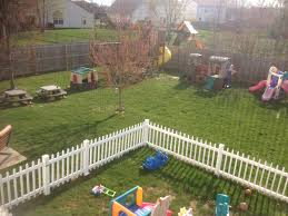 outdoors play areas white fence keeps toddlers in fence within