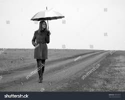 lonely umbrella country road photo stock photo 90963341