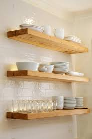 glass shelf between kitchen cabinets add a minimalist look to your space with floating shelves