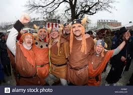 tuesday costumes carnival revelers in viking costumes pose at the victuals market