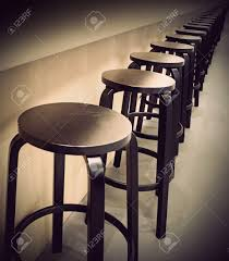 Furniture Row Bar Stools Row Of Empty Bar Stools With Vintage Look Stock Photo Picture And