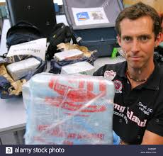 german customs officer grauer presents a bag with seized stock
