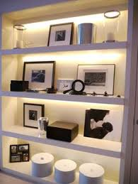 shelf with lights underneath use our glow in the dark wall plate inserts and never fumble for a