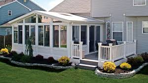 exterior sunroom ideas with glass window and wood wall plus white