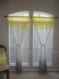 interior tall arched window with roller blind and sheer ombre