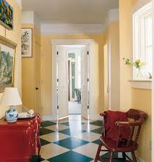 parchment yellow walls in this entry hall colorful home
