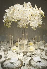 wedding flowers table decorations green and white flower arrangement
