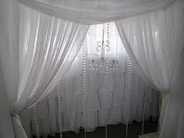 wedding backdrop garland white curtain backdrop with garland and mini chandelier