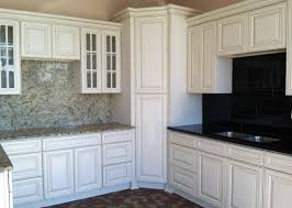 Laminated Timber Floor Dark Shabby White Tile Backsplash White Cabinets Black Countertops