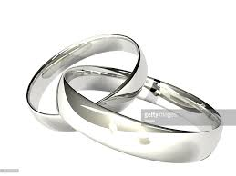 wedding ring images two platinum or silver wedding rings reflected candles stock photo