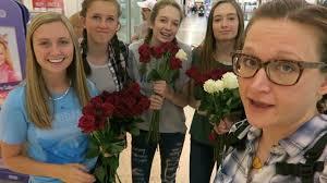 strangers flowers random act of kindness giving flowers to strangers