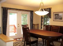 dining room dark table light chairs patio door safety bar