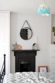 apartment baffling the old cast iron fireplace and small bedroom