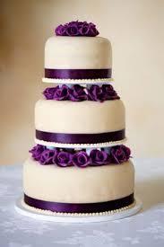 ribbon wrapped wedding cake purple ribbon purple roses
