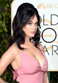 katy perry wears a low cut dress on the golden globes red carpet