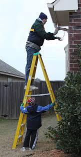 danz family putting up lights