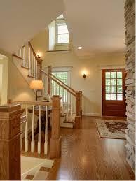 Foyer Stairs Design Golden Oak Stained Foyer Stairway Houzz