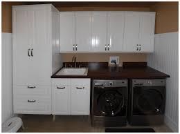 amazing white laundry room with best front load washing machine