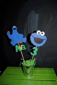 cookie monster centerpiece stick with childs name and age i make