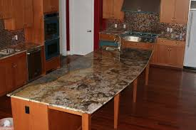 Baltic Brown Granite Countertops With Light Tan Backsplash by Kitchen H Green Baltic Brown Granite Kitchen Countertop Granix
