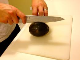 how to cut an avocado and avoid cutting yourself the informed