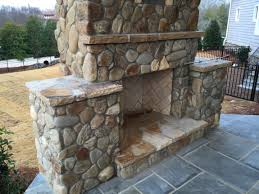 river rock and patterned bluestone outdoor living in charlotte