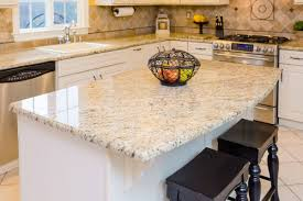 granite countertop full height cabinets green glass backsplash