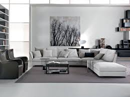 Bedroom Grey Carpet White Walls The Holiday Sofa Takes Centre Stage Along With Shelving Tables