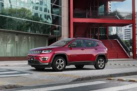 jeep compass limited red 2017 jeep compass poses for the camera in all trim levels