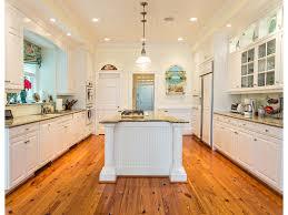 kitchen beamed ceiling countertops glass backsplash kitchen