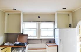 how to install cabinets with uneven ceiling hanging kitchen cabinets on uneven walls hanging kitchen