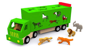 trucks for children learn wild animals in english cartoons for