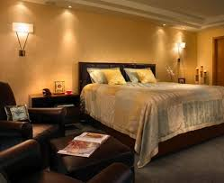 Bedroom Lighting Options - brown bed cover with white headboard and soft carpet ceramic floor