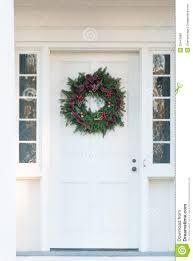 green christmas wreath on door royalty free stock photos