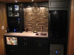 rectangle brown stone brick combined with black wooden cabinet