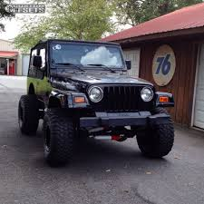 jeep wrangler custom black wheel offset 1999 jeep wrangler super aggressive 3 5 suspension