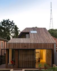 cutaway roof house has a courtyard sliced out of one side house
