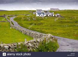 street and houses in the south of fair isle united kingdom stock