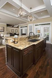 pictures of kitchen designs with islands brown over the kitchen sink lighting architecture designs island