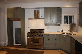 nice white wooden color kitchen corner cabinets with splay corner