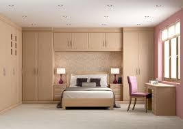 Awesome Bedroom Design With Wooden Wall Mounted Wardrobe Cabinets