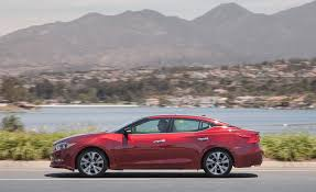 nissan maxima vs ford taurus 2017 nissan maxima in depth model review car and driver